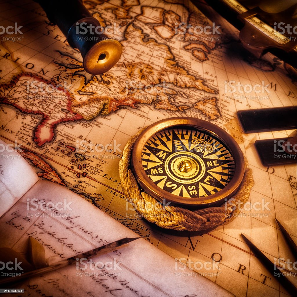Vintage Nautical map, compass, ship's log and other navigational tools stock photo