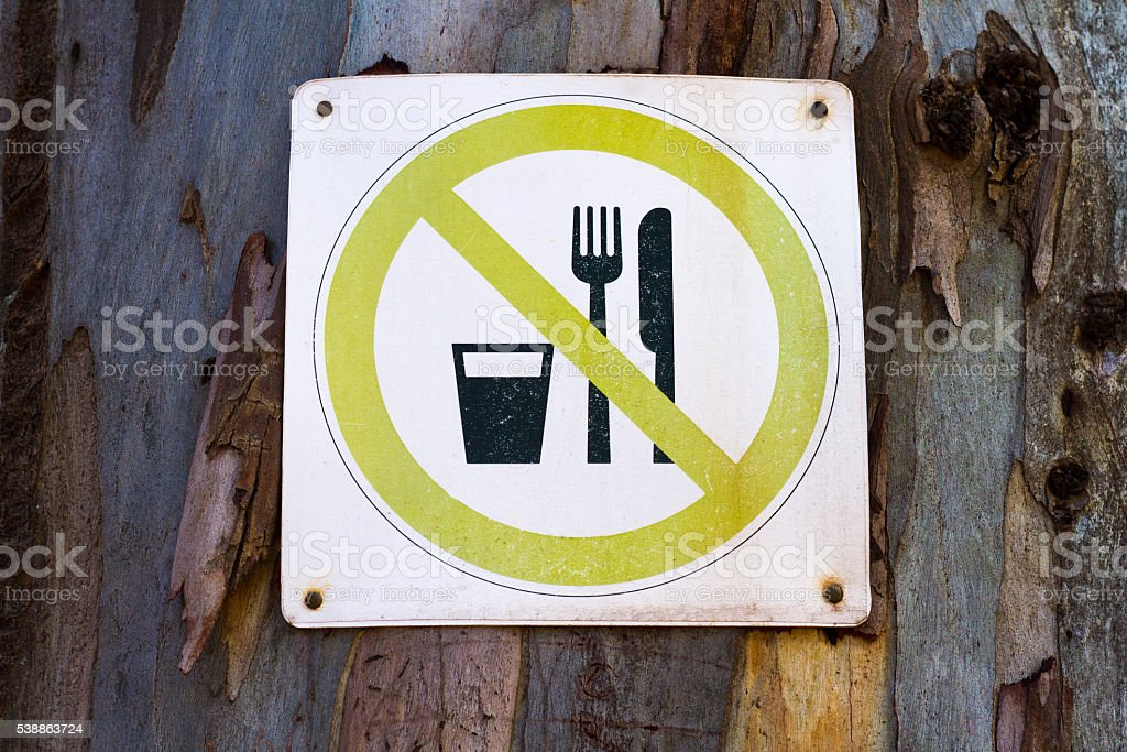 VIntage 'No Eating or Drinking' Sign Posted on Tree stock photo