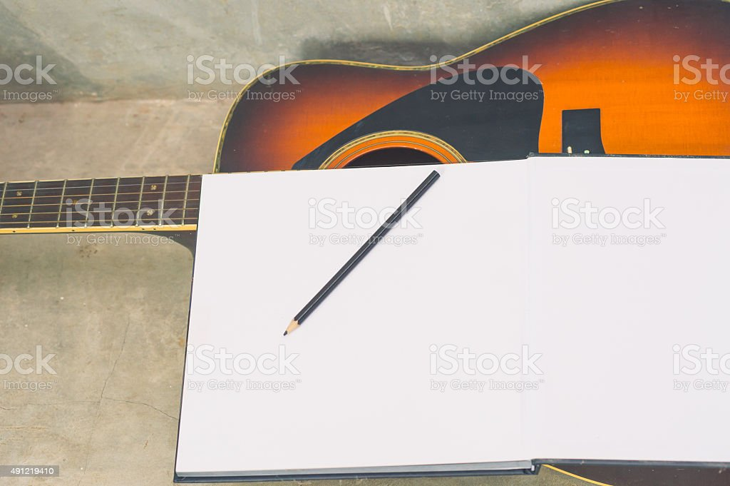 vintage Notebook and acoustic guitar stock photo