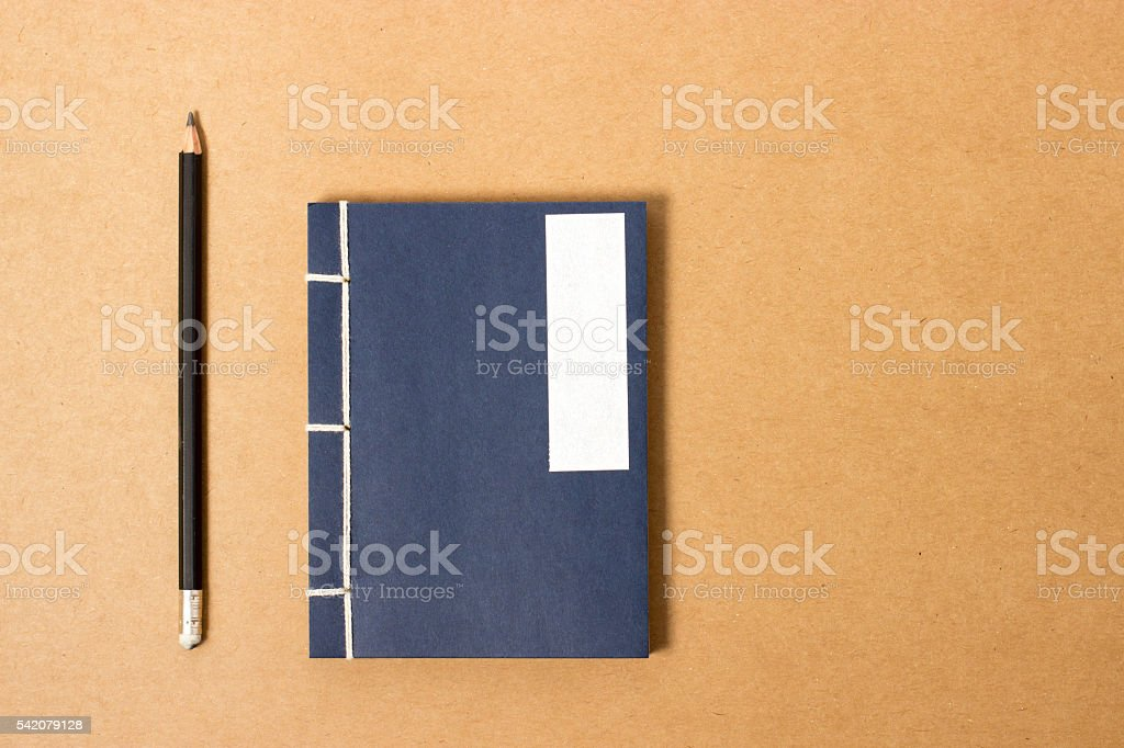 vintage notebook with pencil stock photo
