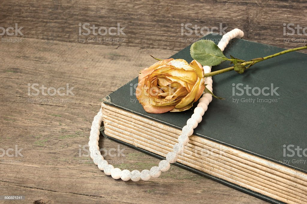 vintage old book and withered rose royalty-free stock photo
