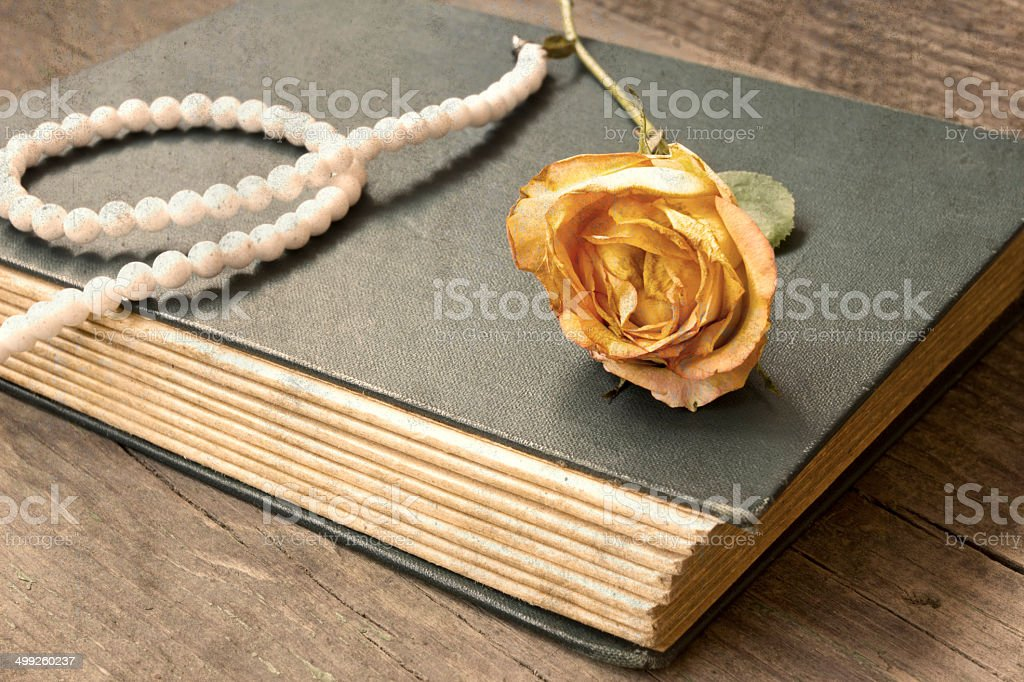 vintage old book and withered yellow rose royalty-free stock photo