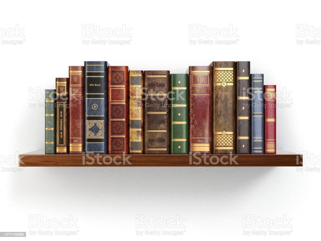 Vintage old books on shelf isolated white. stock photo
