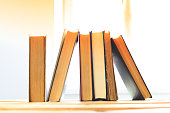 Vintage old books on wooden deck table
