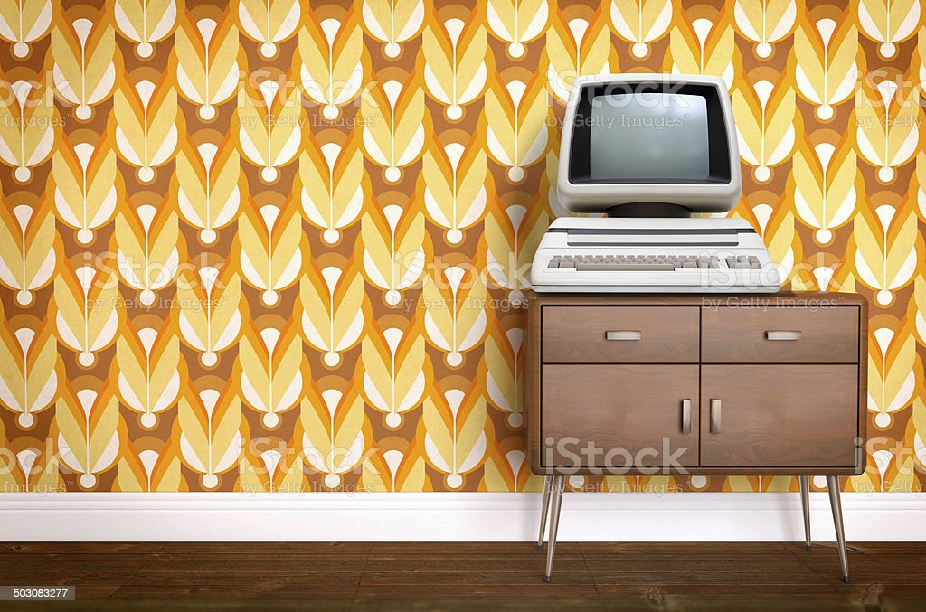 seventies furniture. vintage old computer on sixties seventies wallpaper and furniture royaltyfree stock photo s