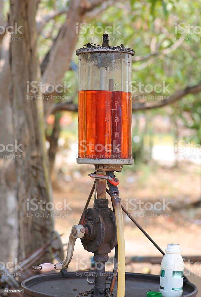 vintage (retro) old fuel dispenser in thailand stock photo