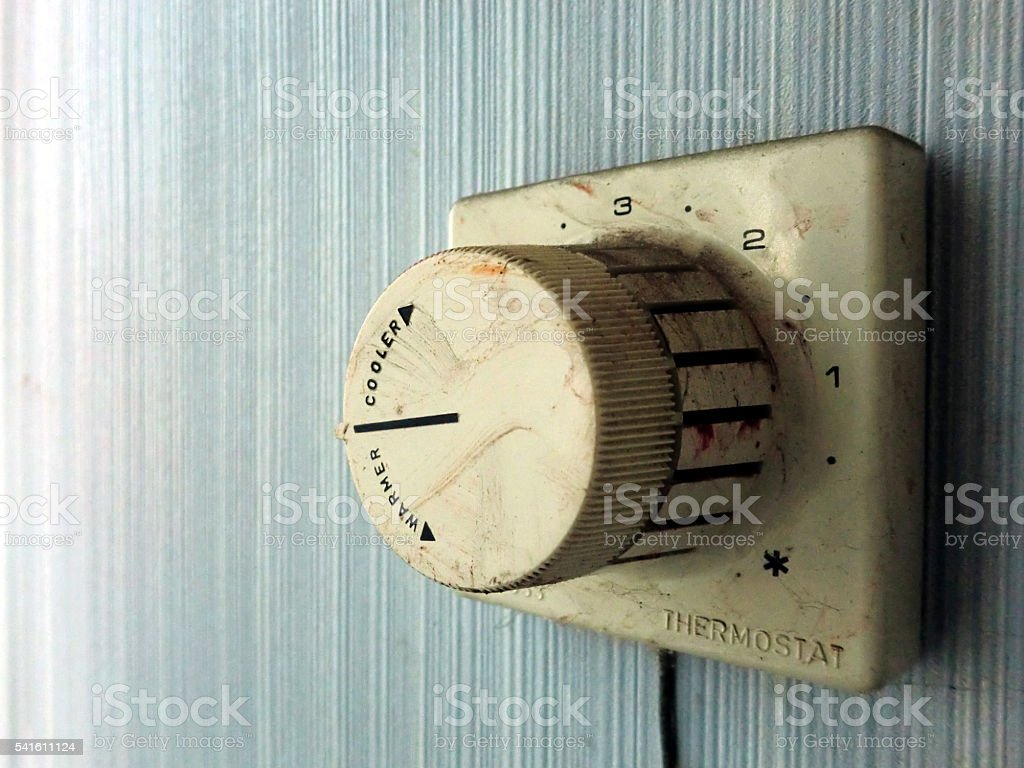 Vintage old grimy electrical thermostat controller dial stock photo