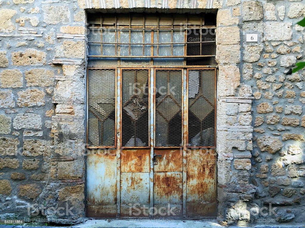 Rusty Metal Door vintage old industrial rusty metal door with broken windows stock
