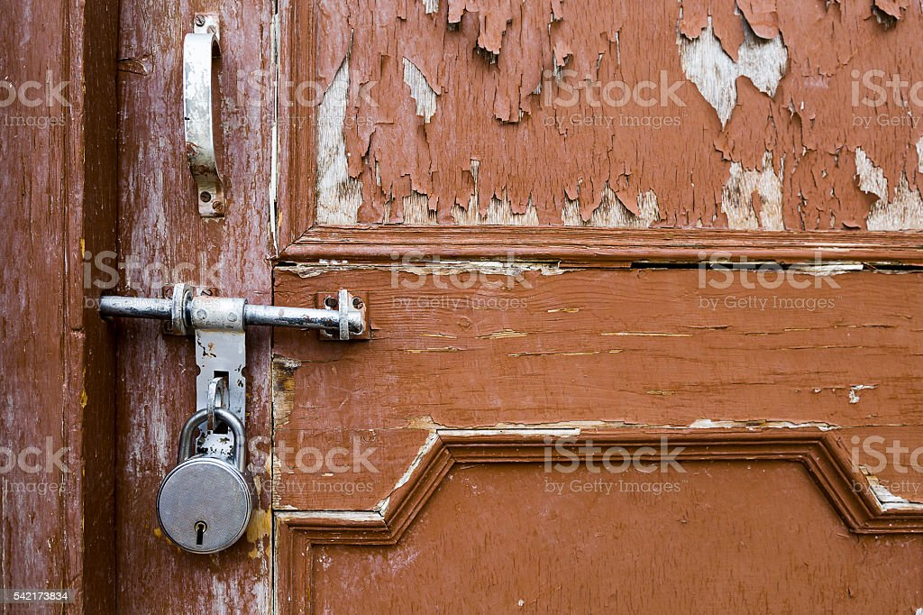 vintage old key lock on wooden door. stock photo