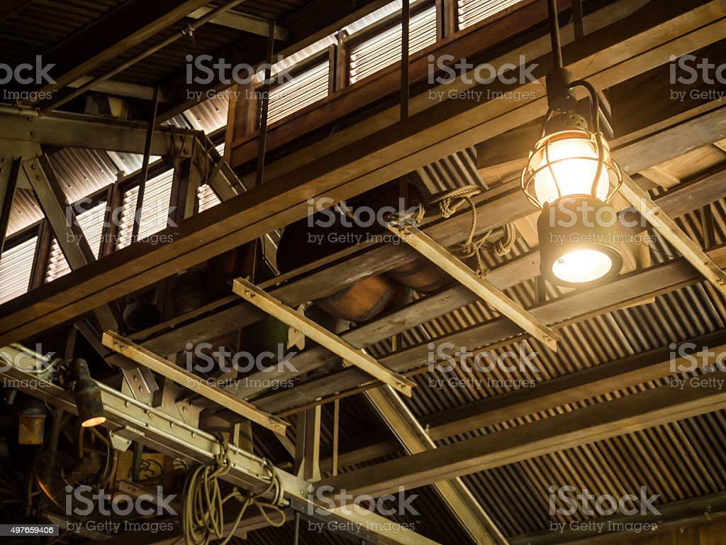 Vintage old latern lamp in barn stock photo