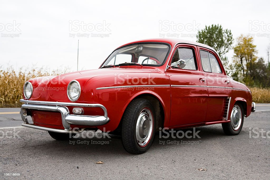 A vintage old red car in decent shape stock photo