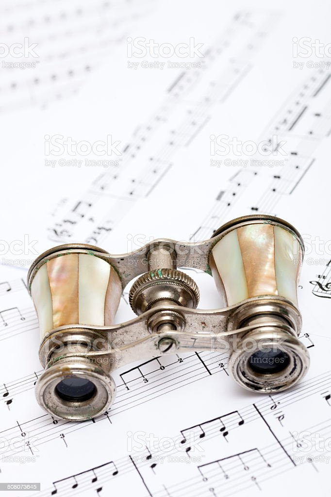 Vintage Opera Glasses on >Sheet Music royalty-free stock photo