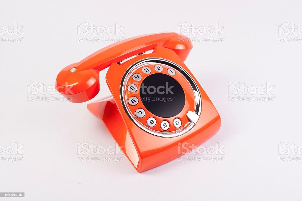 Vintage Orange Telephone Isolated over White Background stock photo