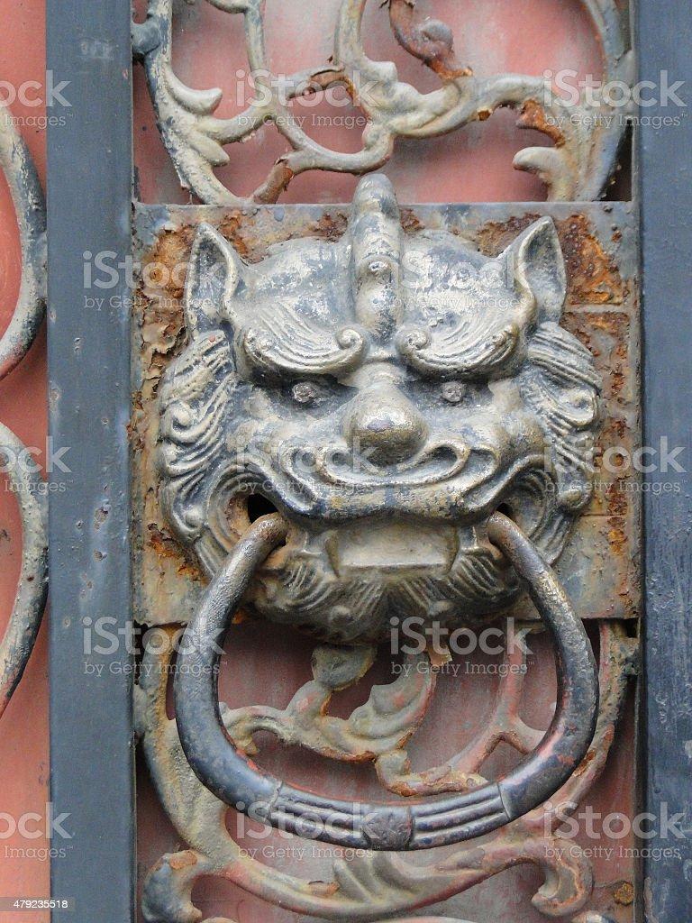 Vintage oriental door knocker , China stock photo