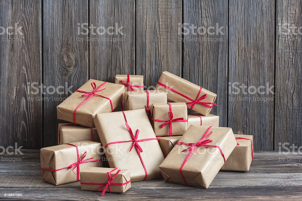 Vintage packages against the background of the old wooden boards stock photo