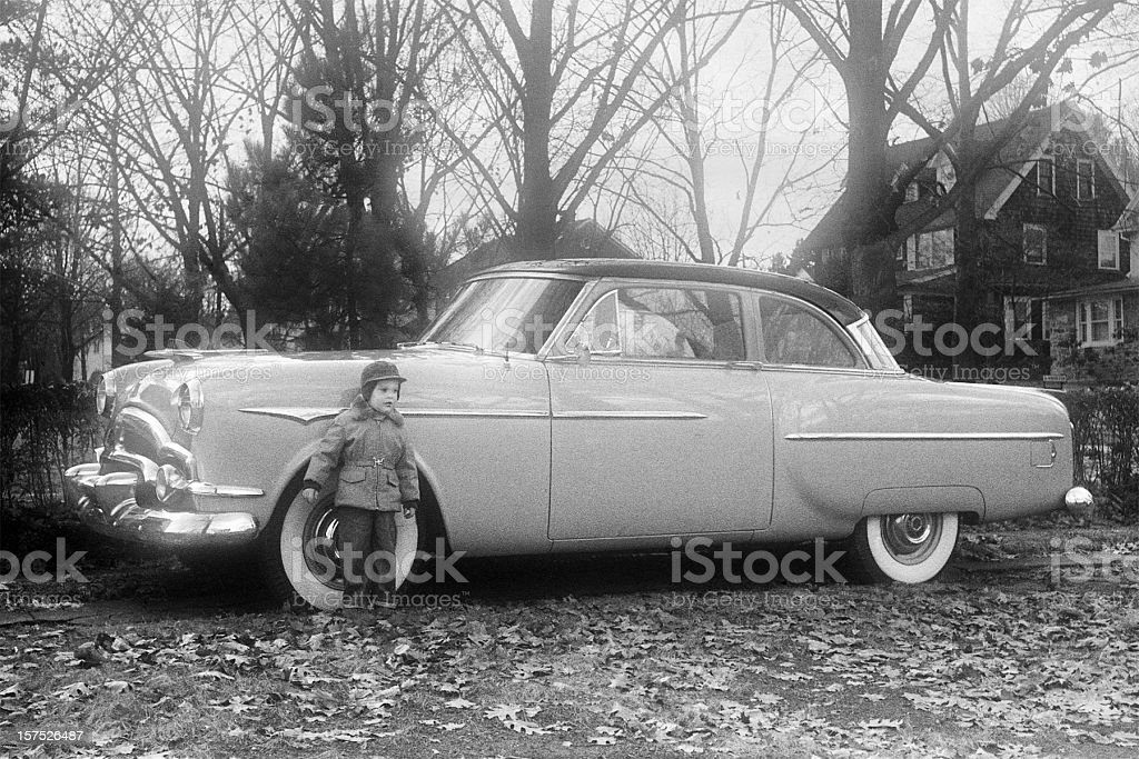 vintage Packard Coupe with little boy 1955, retro stock photo