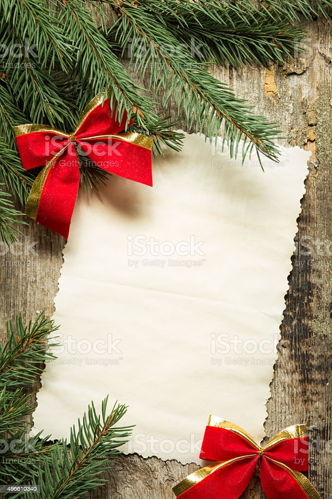 Vintage paper card with christmas decoration stock photo