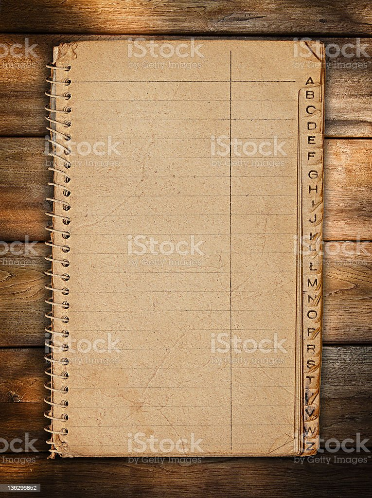 Vintage paper notebook at wood stock photo