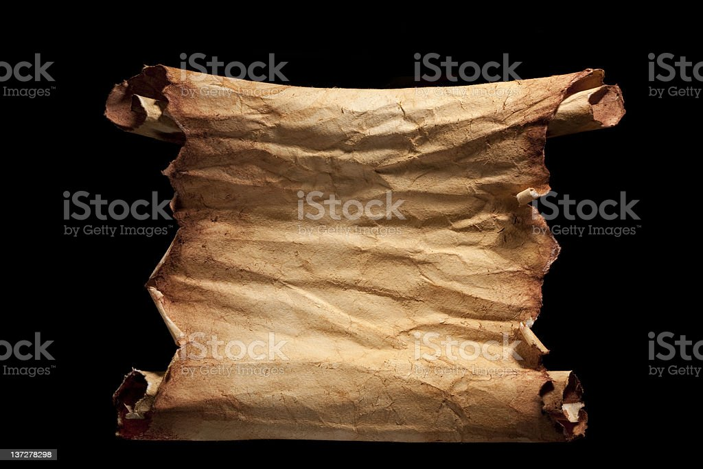 Vintage paper scroll isolated on black. stock photo