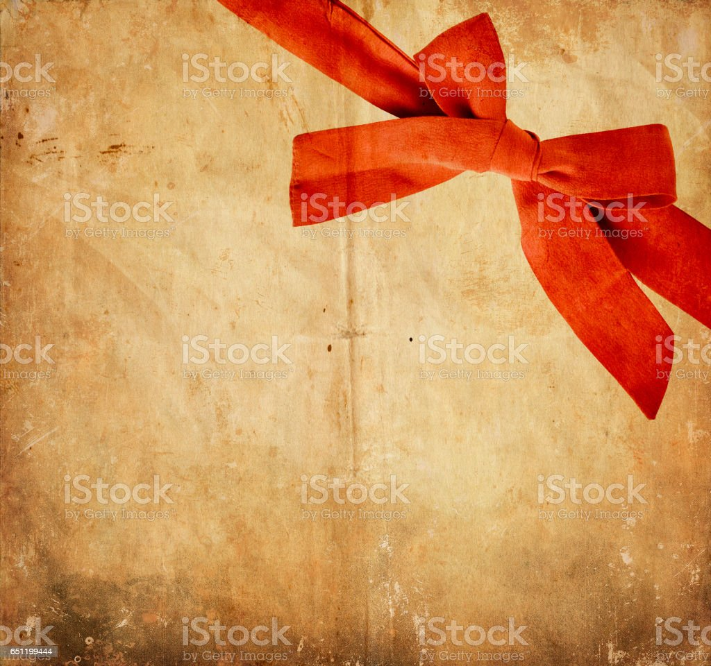 Vintage paper with red bow vector art illustration