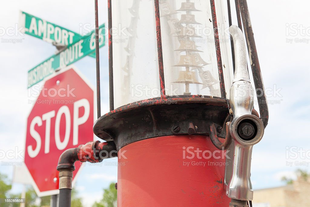 vintage petrol pump at Route 66 with stop street sign royalty-free stock photo