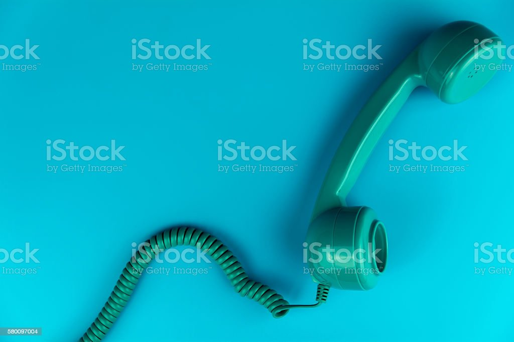 Vintage Phone on a Blue Background stock photo
