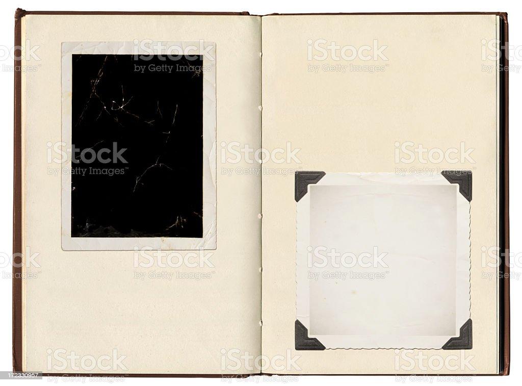 A vintage photo album with photo corners holding photos royalty-free stock photo