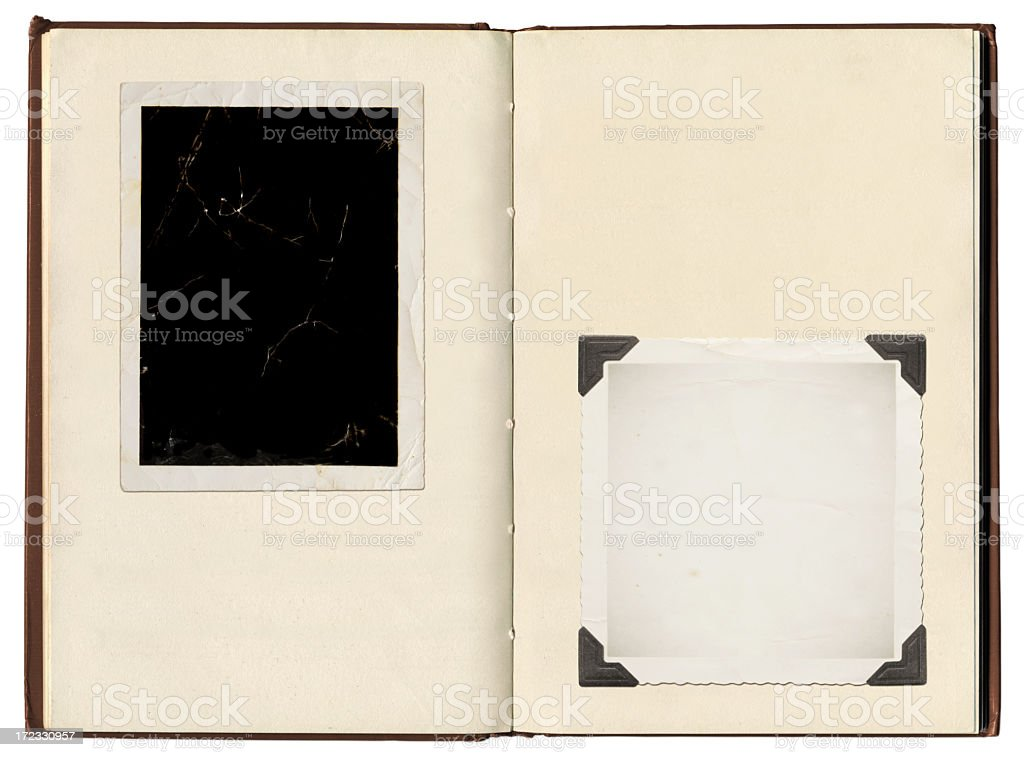 A vintage photo album with photo corners holding photos stock photo