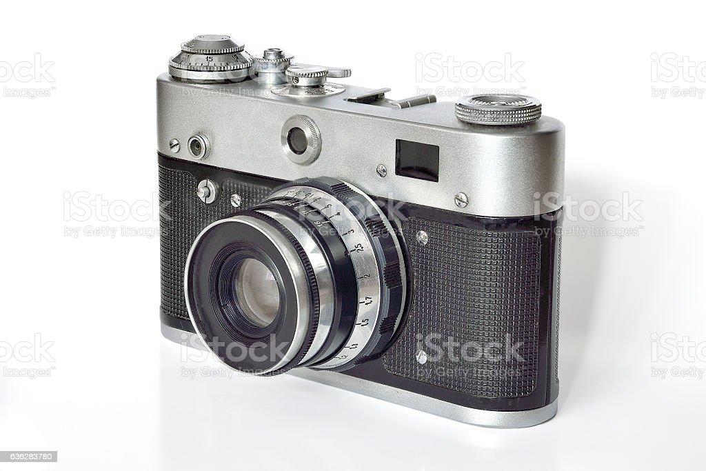 Vintage photo camera on a white background. stock photo