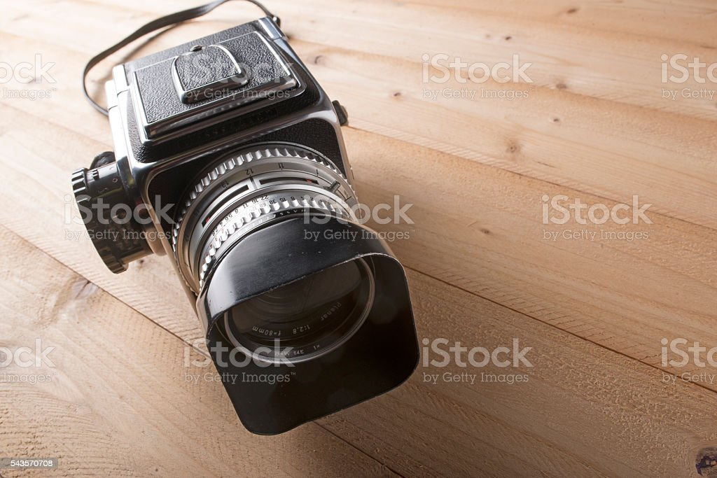 vintage photo camera on wooden table stock photo