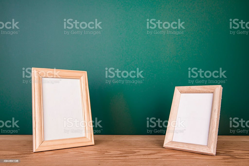 Vintage photo frame on wooden table stock photo
