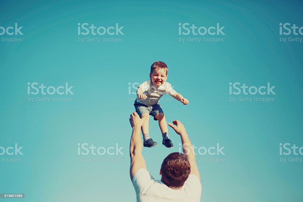 Vintage photo happy father and child having fun outdoors stock photo