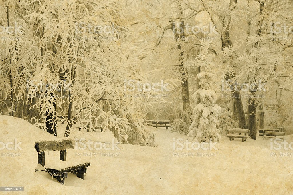 vintage photo of a snow covered bench royalty-free stock photo