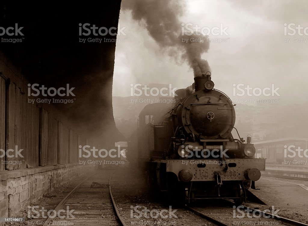Vintage photo of a steam train leaving a station stock photo