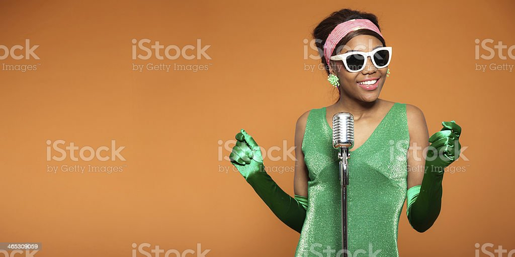 Vintage photo of an African soul funk woman singing stock photo