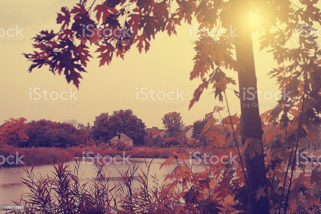 Vintage photo of autumn scene with lake royalty-free stock photo