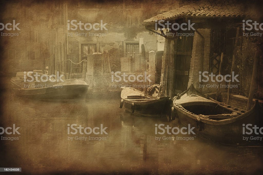Vintage photo of boats in venetian canal royalty-free stock photo