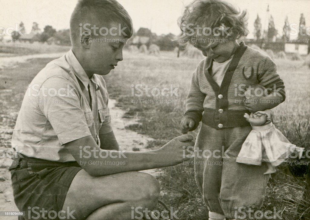 Vintage photo of brother and his little sister stock photo
