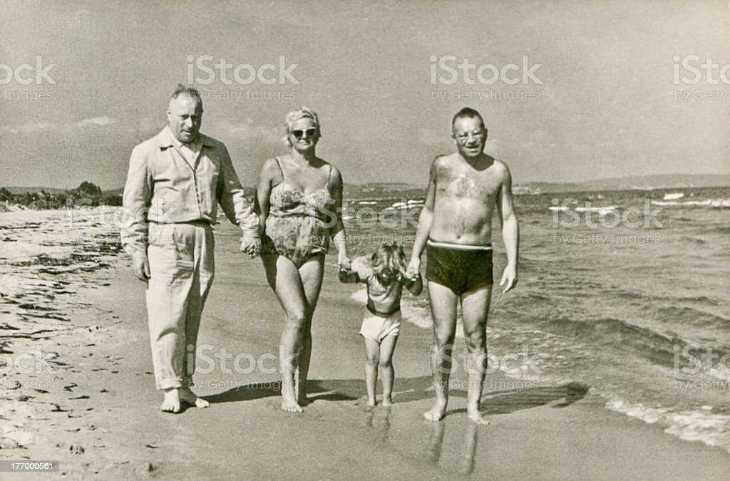 Vintage photo of family on beach stock photo