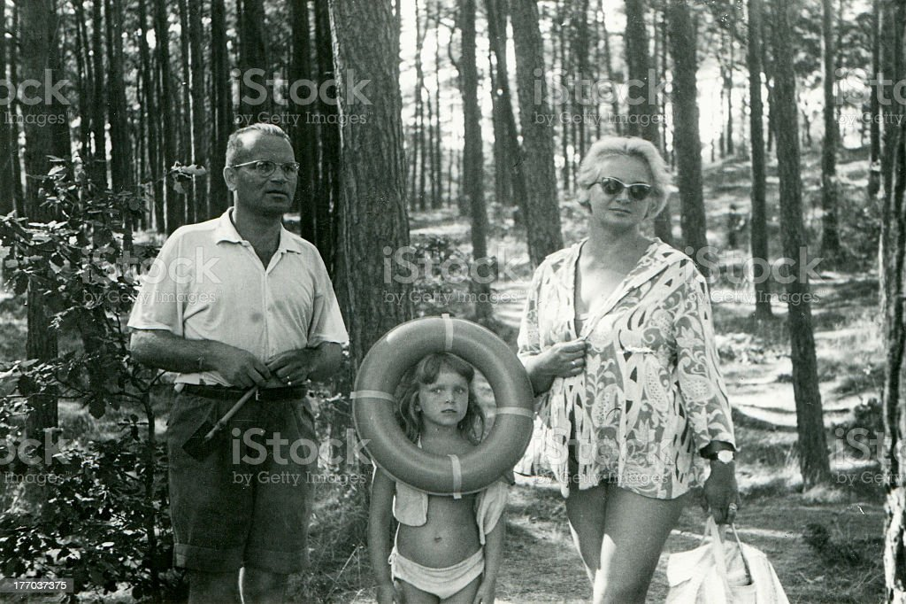 Vintage photo of happy family in grey and white stock photo