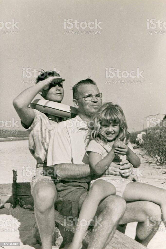 Vintage photo of happy family on beach stock photo