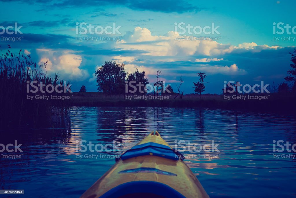 Vintage photo of kayaking by Krutynia river in Poland stock photo