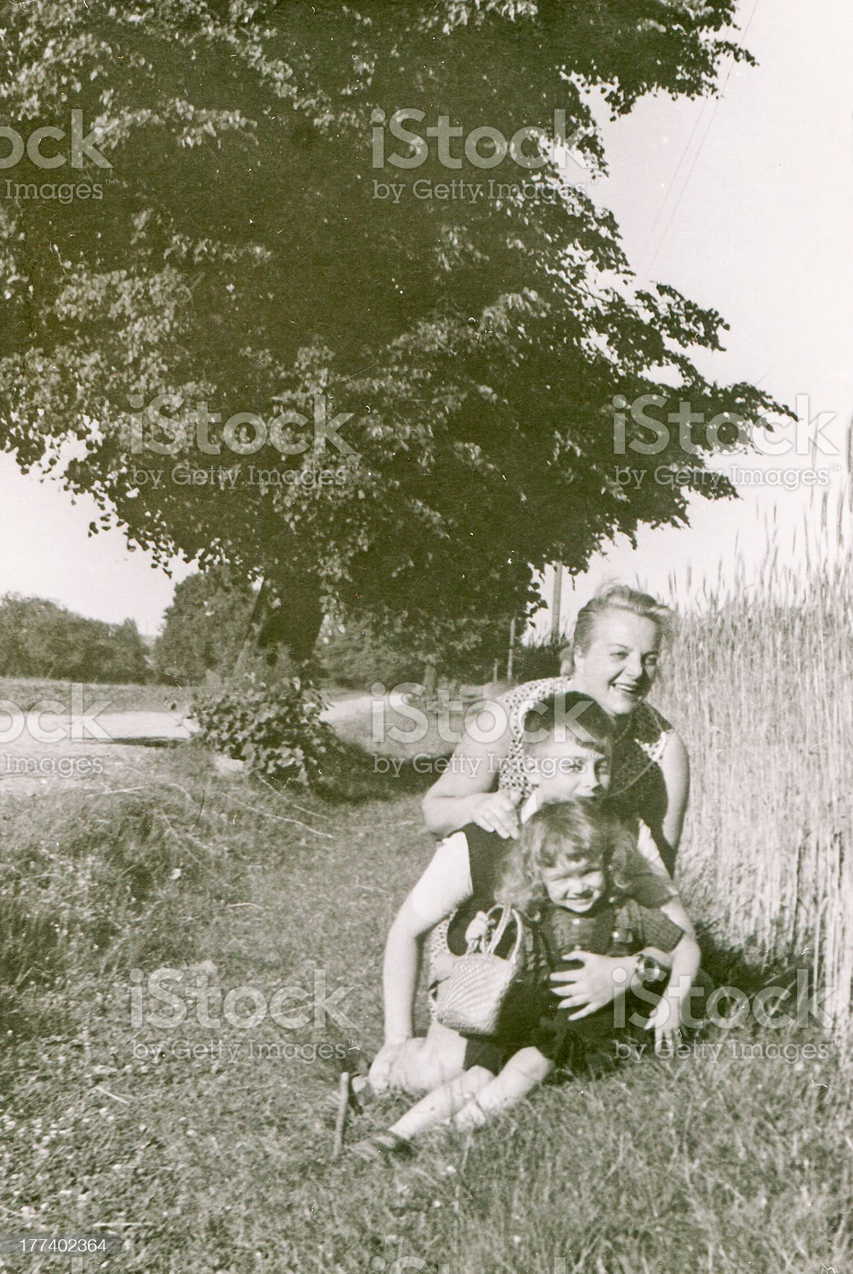 Vintage photo of mother and children outdoor royalty-free stock photo
