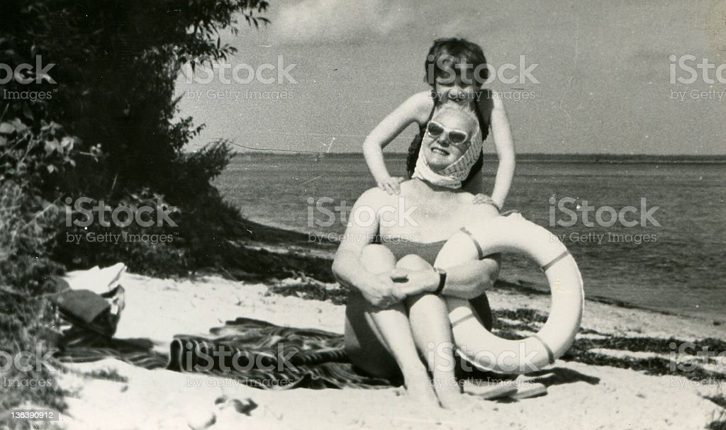 Vintage photo of mother and daughter on beach stock photo