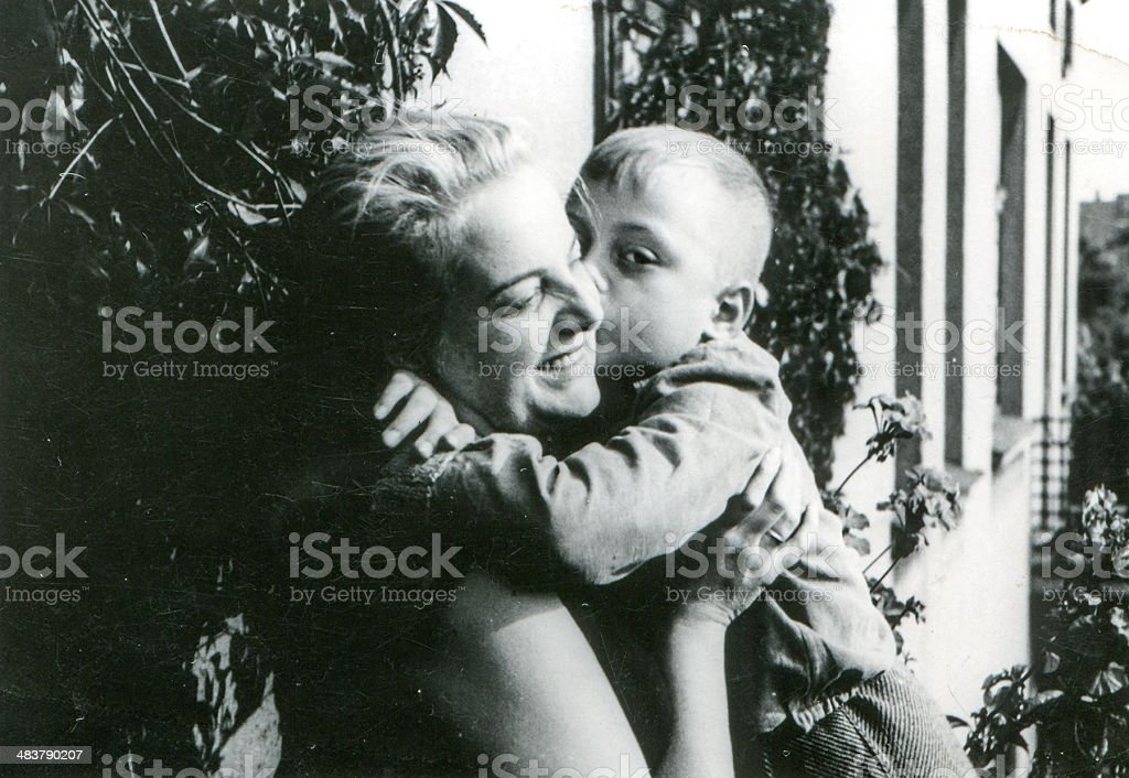 Vintage photo of mother and son on balcony stock photo