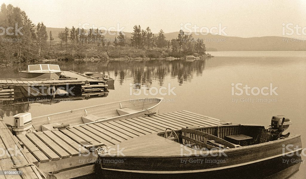 Vintage Photo of Motorboats Docked in Cottage Country stock photo