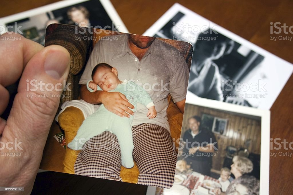 Vintage photo of sleeping baby girl held by father royalty-free stock photo