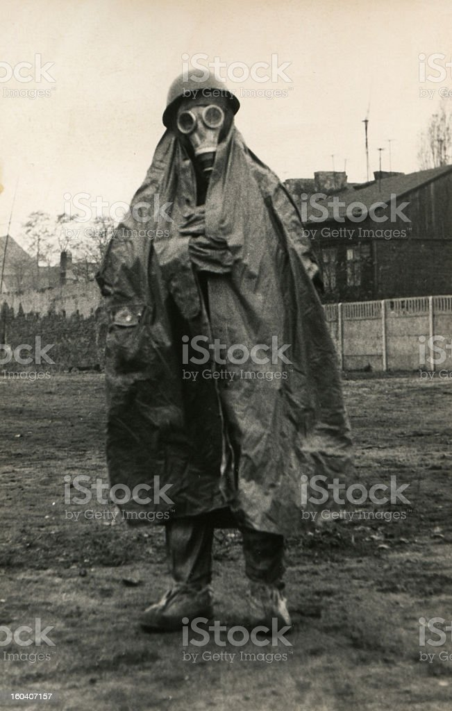Vintage photo of soldier in gas mask and protective clothing stock photo