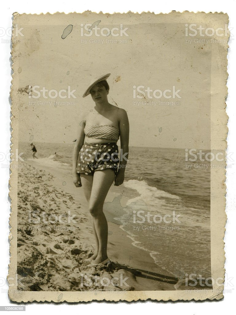 Vintage photo of woman on beach stock photo