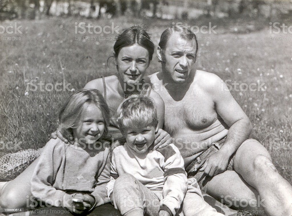 Vintage photo of young couple with children in garden stock photo